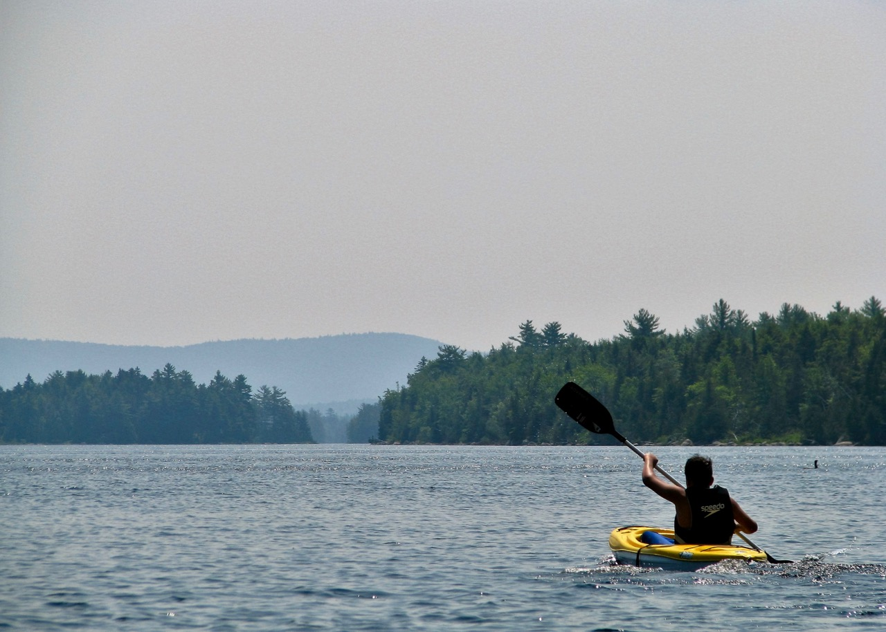 Kayaking teen on Nicatous Lake