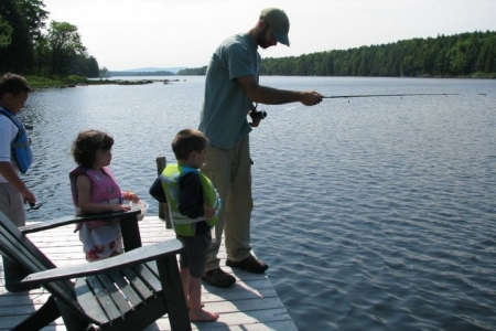 Brian Tyne helping children fish