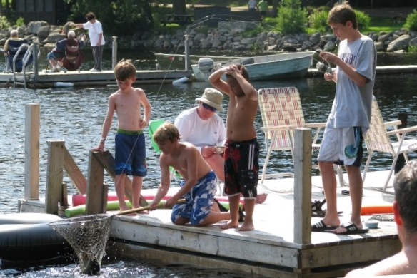 Kids catching a fish from the dock